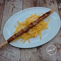 Carne cotta sul bastone